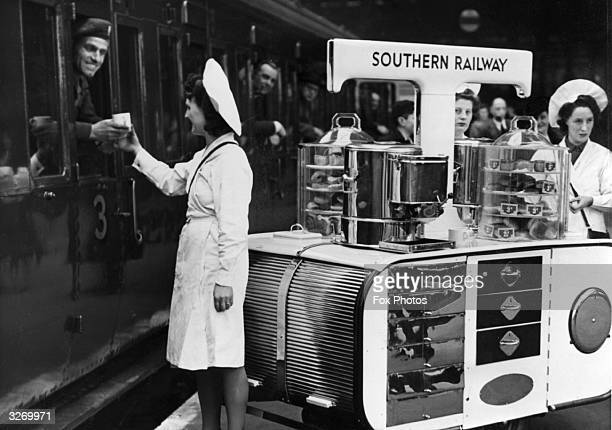 One of the Southern Railway's new tea trolleys in service at Waterloo Station London It carries enough hot water for 300 cups of tea as well as...