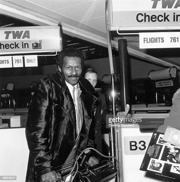 Legendary rock 'n' roll singer songwriter and guitarist Chuck Berry checks in at the airport March 1975