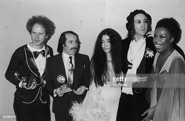 LR Art Garfunkel Paul Simon Yoko Ono John Lennon and Roberta Flack pose together backstage at the Grammy Awards Uris Theater New York City Garfunkel...