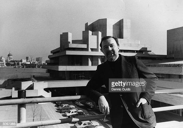 Director Sir Peter Hall on Waterloo Bridge in front of the National Theatre which is about to stage its first public performance