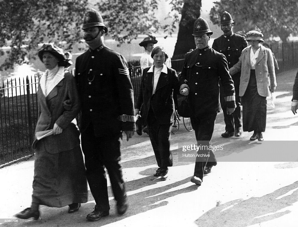 Arrested protesters are led away by the police, after the suffragette attack on Buckingham Palace.