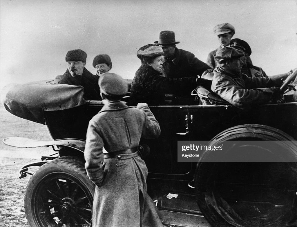 Russian revolutionary leader Vladimir Ilyich Lenin (1870 - 1924), far left, is joined in the car by his wife Nadezhda Konstantinova Krupskaya and his sister Maria Ulyanova, ready to leave for Khodinsoye Polya after a military parade.
