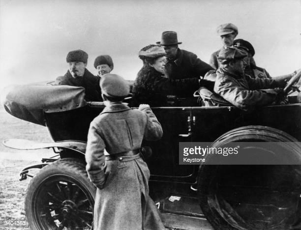 Russian revolutionary leader Vladimir Ilyich Lenin far left is joined in the car by his wife Nadezhda Konstantinova Krupskaya and his sister Maria...
