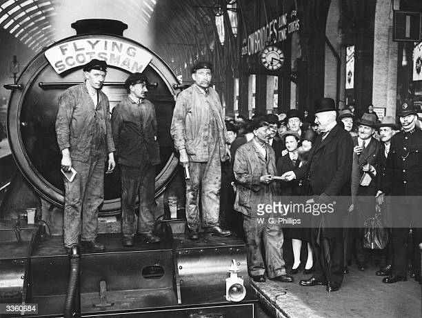 The arrival of the Flying Scotsman at King's Cross railway station in London William Whitelaw greets driver J Day fireman Gray fireman McKenzie and...