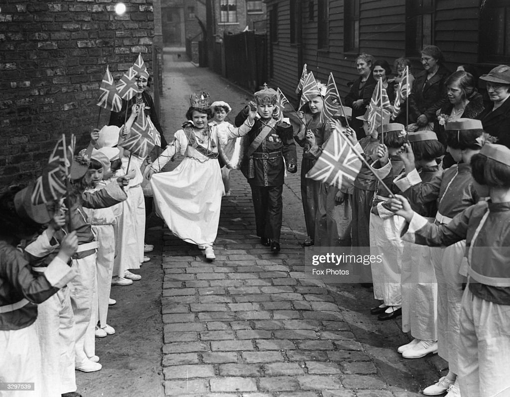 Children in Ann Street, South Reddish, Manchester, during a dress rehearsal for their coronation celebrations at the time of the coronation of King George VI and Queen Elizabeth.