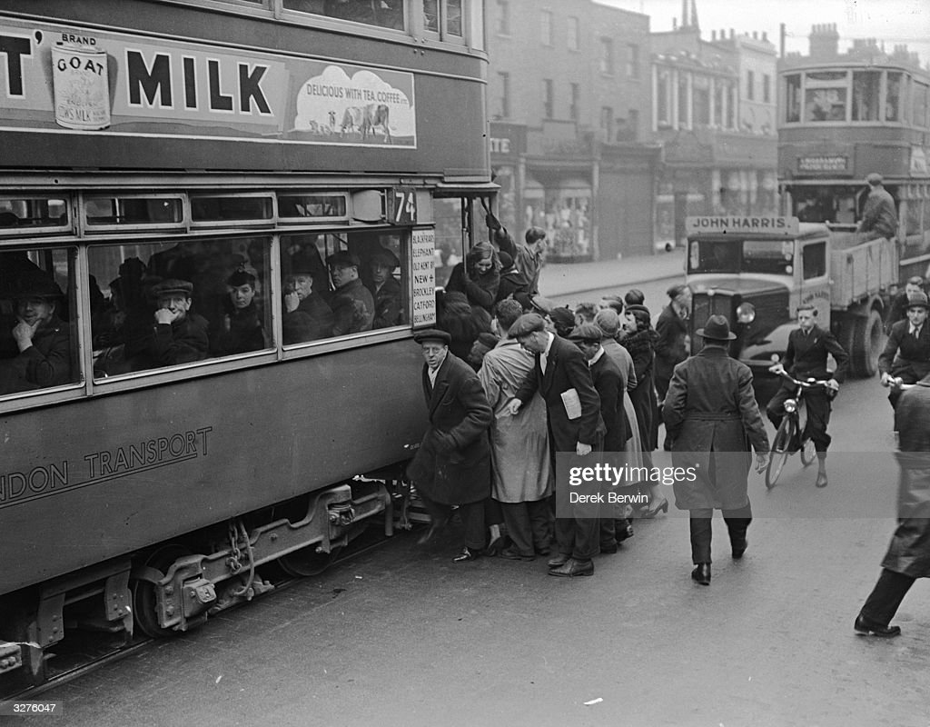 People boarding a tram in the Old Kent Road, London.