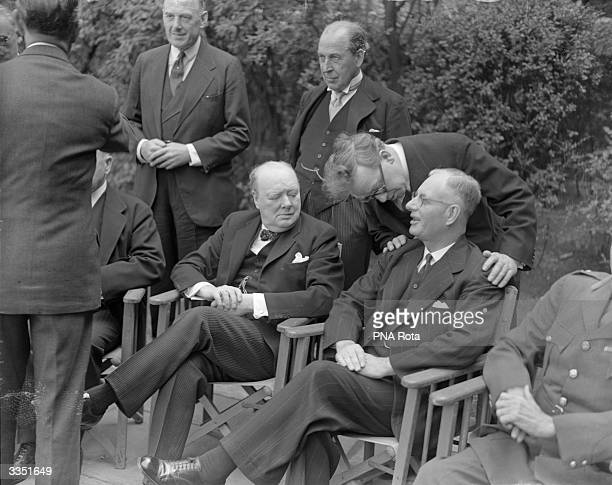 Herbert Morrison in friendly conversation with Australian Prime Minister John Curtin while Winston Churchill looks on Empire premiers have gathered...