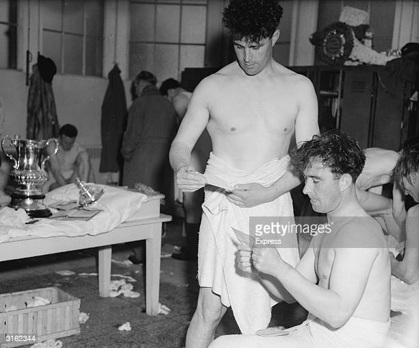 Arsenal players Denis Compton and his brother Leslie in the dressing room after their team won the FA Cup Final
