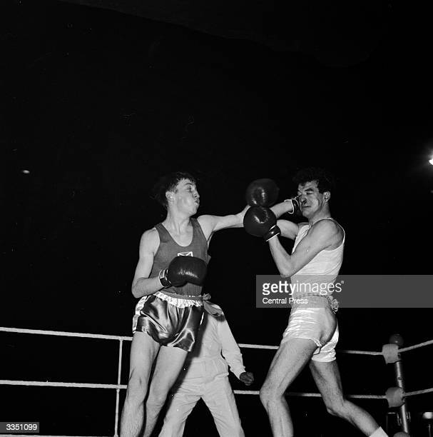Ken Buchanan lands a hard left on the face of opponenet J Isaac during a bout at the ABA finals at Wembley stadium in London