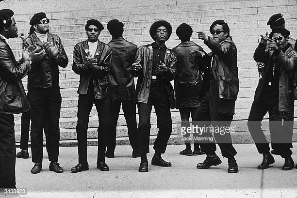 Members of the Black Panther party demonstrate outside the Criminal Courts Building one month after 21 Panthers were charged with plotting to...