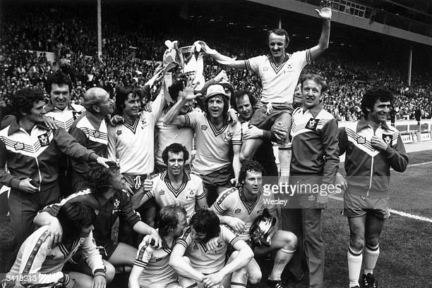The jubilant Southampton football team celebrate with the trophy after their 10 victory over Manchester United in the FA Cup Final at Wembley Stadium...