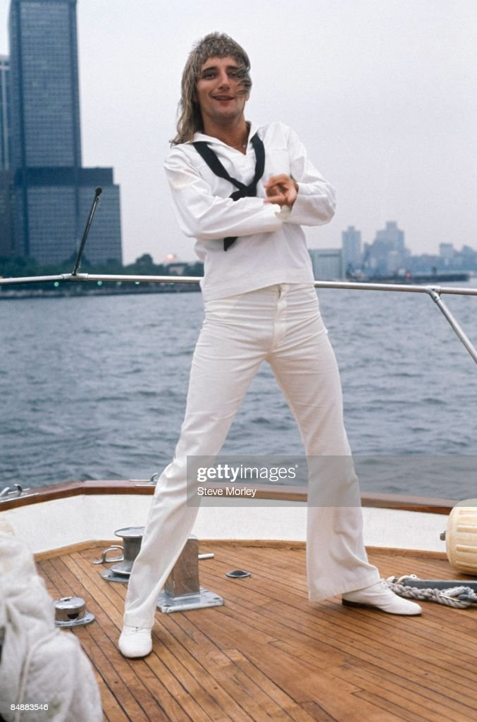 British singer Rod Stewart posed on a boat in New York Harbour at a press event to promote his new album, Atlantic Crossing while dressed in sailor costume in May 1975.