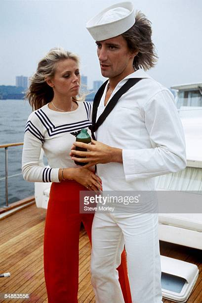 British singer Rod Stewart posed on a boat with Britt Ekland in New York Harbour at a press event to promote his new album Atlantic Crossing while...