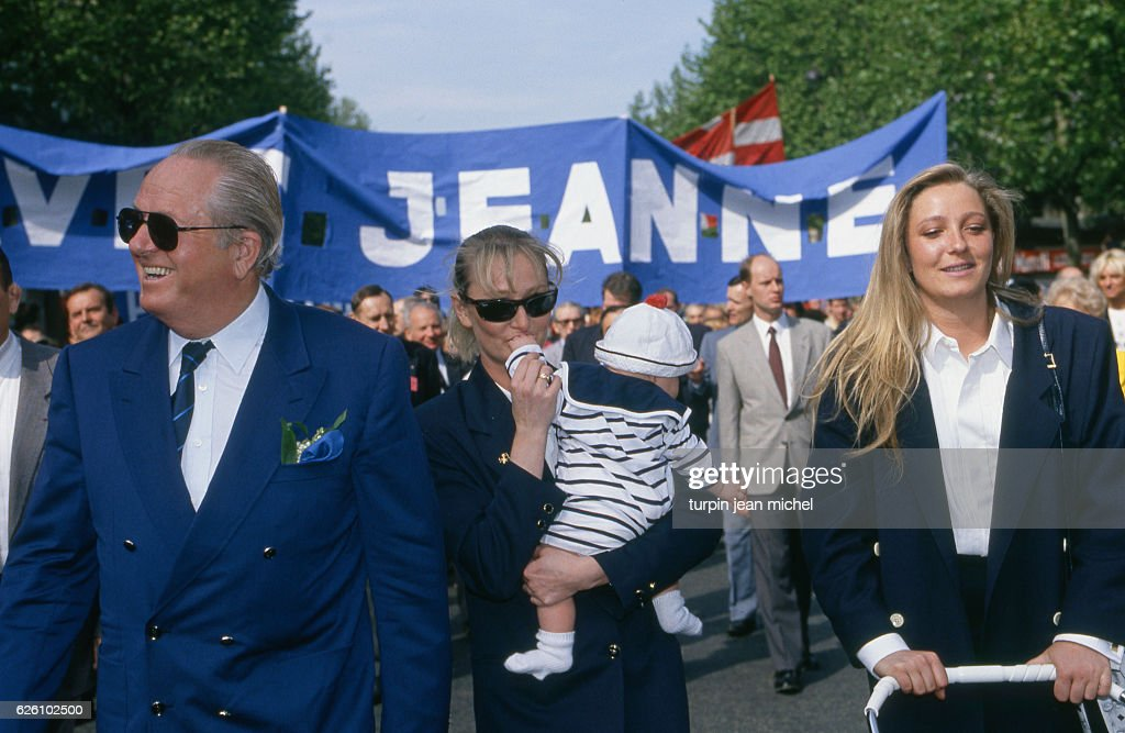 1st May march of the French far right-wing and nationalist politician, founder and President of the National Front (Front National - FN) Jean-Marie Le Pen with his daughters 1st May march of the French far right-wing and nationalist politician, founder and President of the National Front (Front National - FN) Jean-Marie Le Pen with his daughters Yann (holding her daughter Marion) and Marine Le Pen, Paris, France, 1st May 1990.