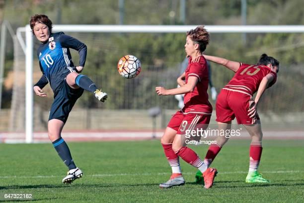 Mizuho Sakaguchi of Japan Women challenges Amanda Sampedro Bustos and Silvia Meseguer Bellido of Spain Women during the match between Japan v Spain...