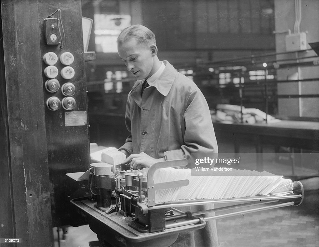 A worker sorting mail at the Mount Pleasant post office, London, using the new mechanical apparatus.
