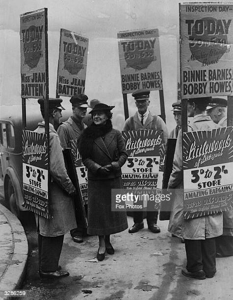 Mrs Jennie Marchant known as 'The Missus' giving instructions to the sandwich board men who work for her