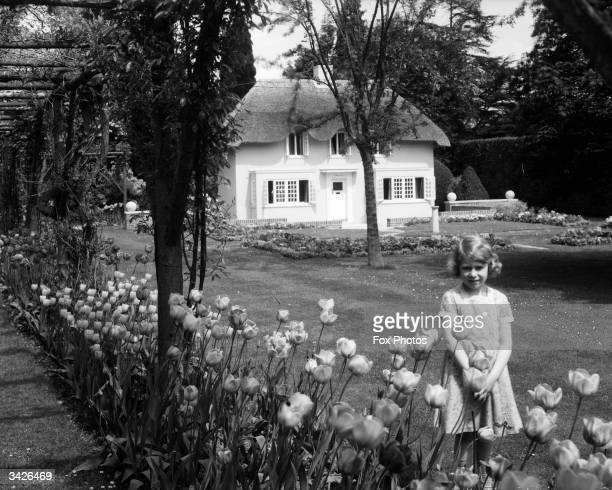 Princess Elizabeth by the Welsh House presented as a gift to her and Princess Margaret by the people of Wales built in the grounds of the Royal Lodge...
