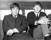 Two members of Liverpudlian pop group The Beatles John Lennon singer and guitarist left and Paul McCartney singer and bass guitarist