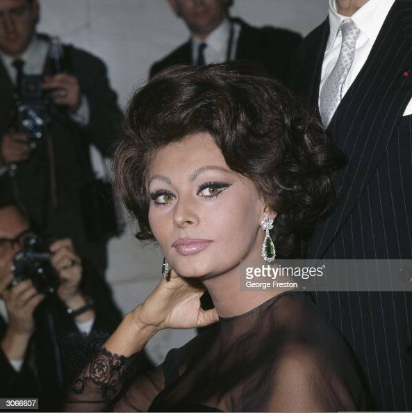 Sultry Italian film star Sophia Loren poses for photographers at the Savoy Hotel London