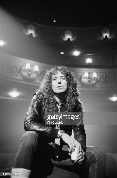 David Coverdale from Whitesnake poses in the stalls at the Lyric Theatre in London during the filming of their video to 'Here I Go Again' in November...