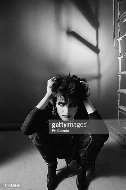 Siouxsie Sioux lead singer with British punk band Siouxsie And The Banshees posed crouching in a studio in London in November 1979