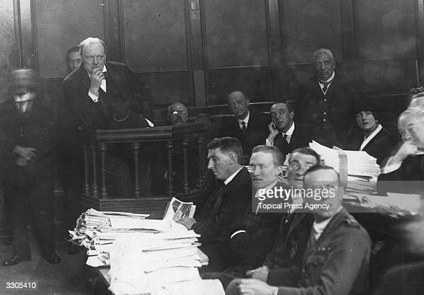 Winston Churchill ponders the situation while standing in the witness box during a Tank Enquiry at Lincolns Inn in October 1919
