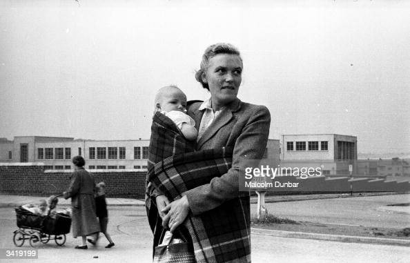 A woman holding a baby wrapped in a tartan blanket in the Scottish industrial town of Kilmarnock Kilmarnock is home to a variety of industries...