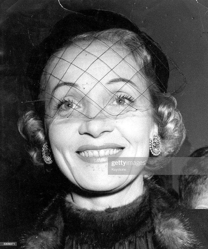 <a gi-track='captionPersonalityLinkClicked' href=/galleries/search?phrase=Marlene+Dietrich&family=editorial&specificpeople=70018 ng-click='$event.stopPropagation()'>Marlene Dietrich</a> (1901 - 1992), formerly Maria Magdalena Von Losch, the German singer and actress who made her career in America.