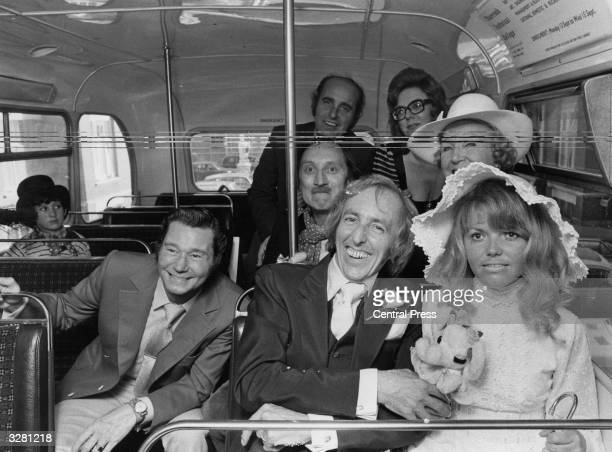Bob Grant star of London Weekend television show 'On The Buses' with his new bride Kim Benwell and other stars from the show travelling on a bus to...