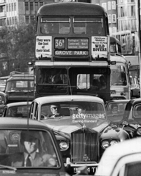 People commuting by bus or car in Park Lane London