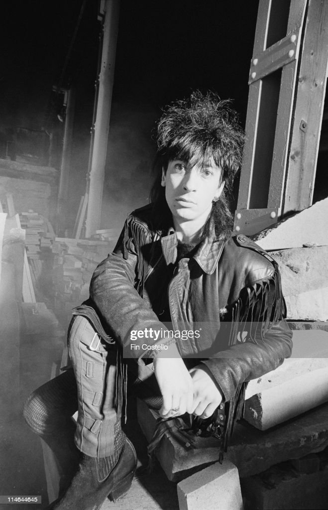 Dave Tregunna from The Lords Of The New Church posed in a stonemason's yard in Islington, London in October 1984.