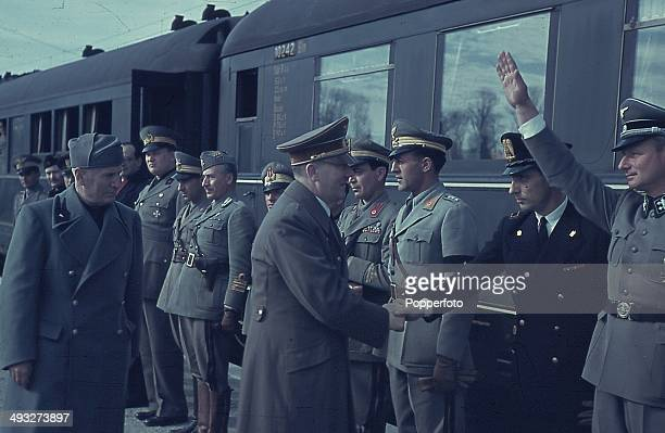 German Chancellor Adolf Hitler meets with Italian Prime Minister Benito Mussolini and Axis officers at the railway station in Florence Italy in...