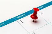 pinned date mark on calendar