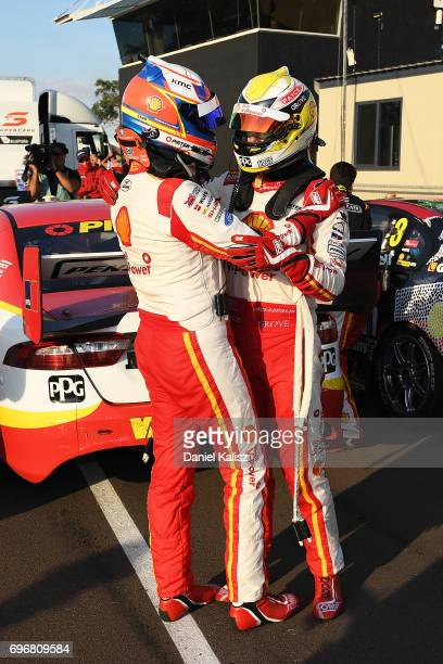 1st place Fabian Coulthard driver of the Shell VPower Racing Team Ford Falcon FGX is congratulated by 2nd place Scott McLaughlin driver of the Shell...