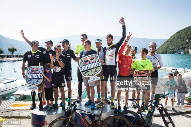 1st place team 'Parapente Mag Boys' 2nd place team 'Team Mag Aviron' and 3rd place team 'Pure Coco' celebrate on the podium during the Redbull...