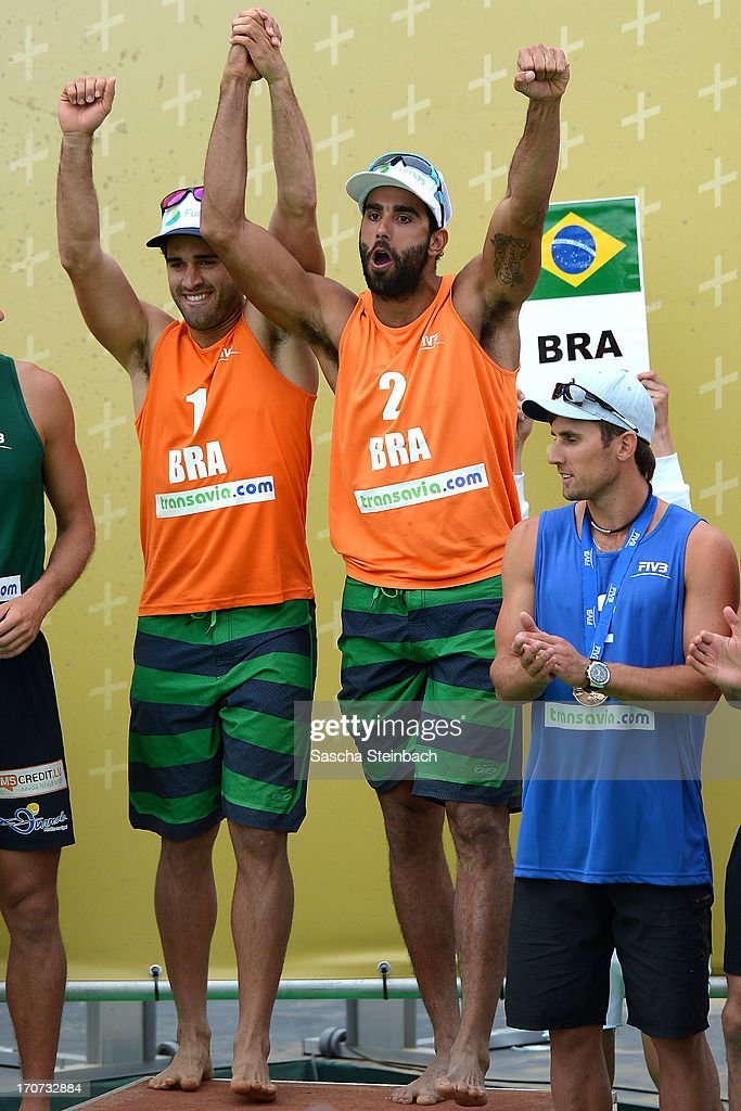 1st place winners Bruno Oscar Schmidt (L) and Pedro Solberg Salgado (R) of Brazil line up on the podium during the FIVB Grand Slam final match day at The Hague Beach Stadium on June 16, 2013 in The Hague, Netherlands.