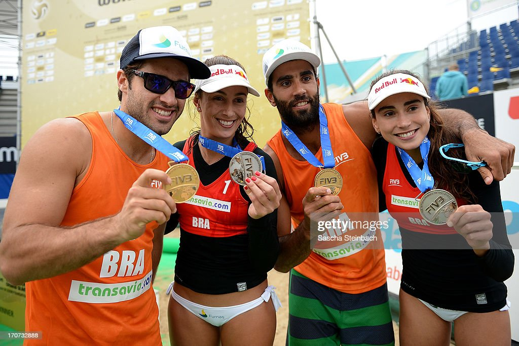 1st place winners Bruno Oscar Schmidt (L) with Pedro Solberg Salgado (2-R) of Brazil and 2nd place winners Maria Clara Salgado Rufino (2-L) with Carolina Solberg Salgado (R) of Brazil show their medals during the FIVB Grand Slam final match day at The Hague Beach Stadium on June 16, 2013 in The Hague, Netherlands.