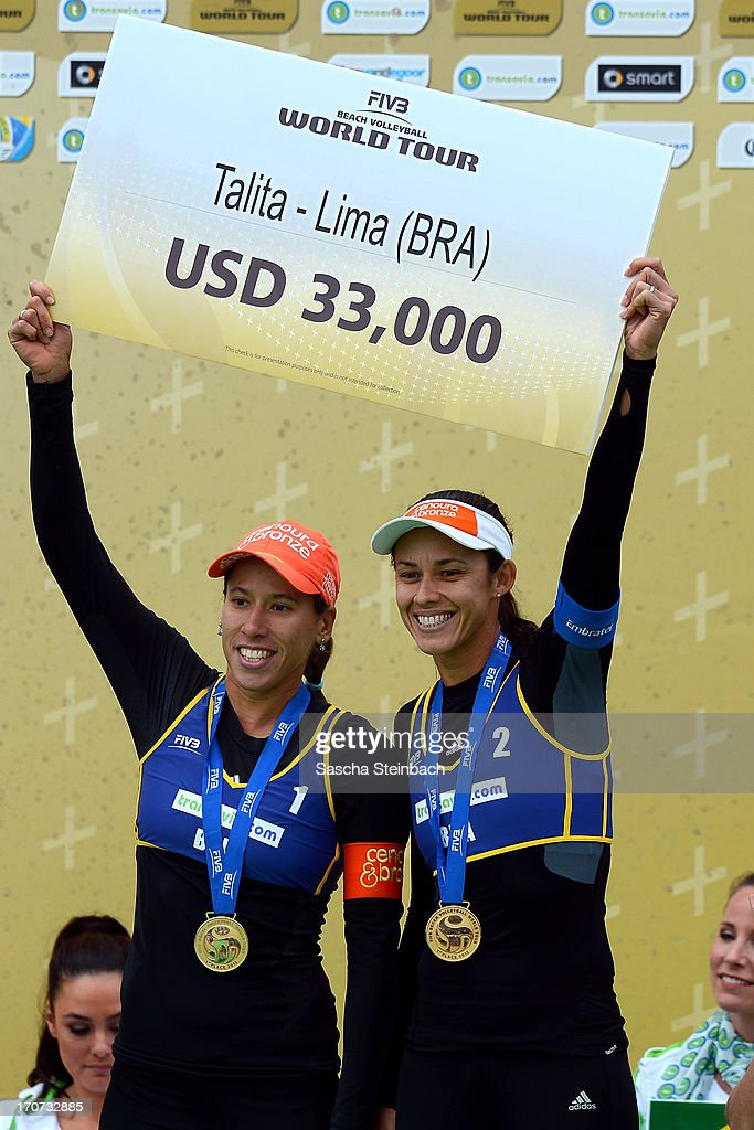 1st place winners Taiana Lima (L) and Talita Da Rocha Antunes (R) of Brazil celebrate with their gold medals during the FIVB Grand Slam final match day at The Hague Beach Stadium on June 16, 2013 in The Hague, Netherlands.