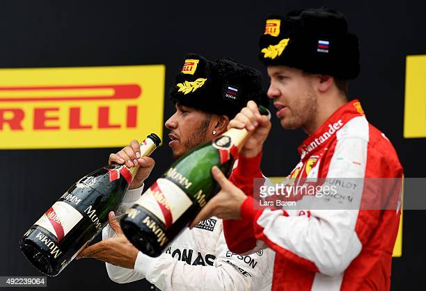 1st placed Lewis Hamilton of Great Britain and Mercedes GP celebrates with 2nd placed Sebastian Vettel of Germany and Ferrari after the Formula One...