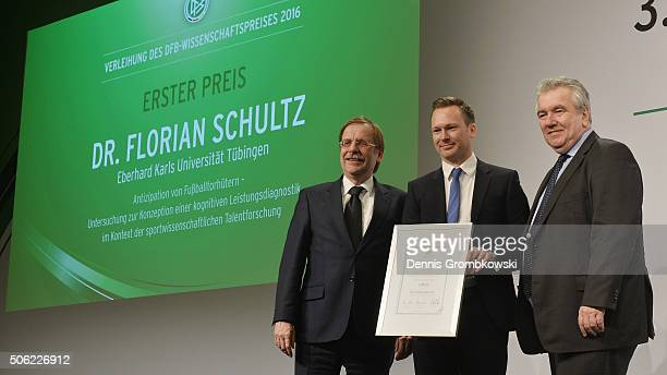 1st Prize winner of the DFB Science Award Florian Schultz poses with Rainer Koch Senior Vice President and Peter Frymuth Vice President Operations...