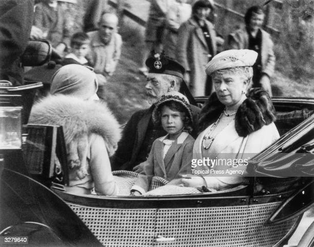 Princess Elizabeth of York with her grandparents King George V and Queen Mary leaving a church service at Crathie in Aberdeenshire Scotland The royal...