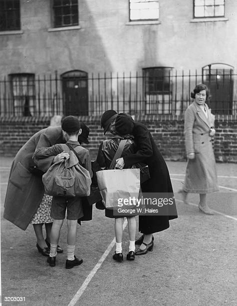 Kissing their children goodbye at St George's School Notting Hill Gate London two mothers pay a fond farewell a few days before World War II...