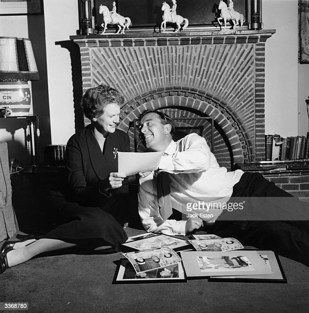 Arsenal football player and England cricketer Denis Compton relaxing at home with his wife Valerie after his knee operation Original Publication...