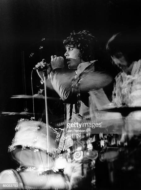 Jim Morrison and drummer John Densmore from American rock group The Doors perform on stage in Denmark in September 1968
