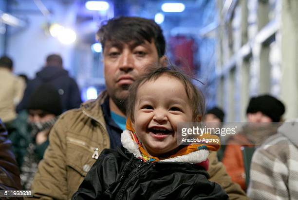 A 1yearold Afghan baby Seher smiles as she is being hosted with his parents at a Turkish Coast Guard ship following a rescue operation named...