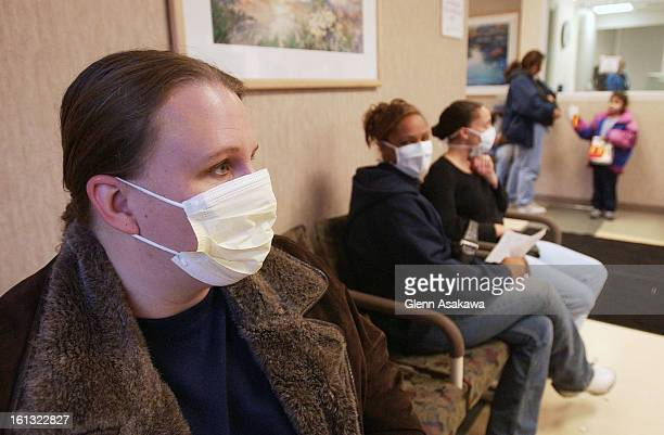 AURORA CO DECEMBER 4 2003Wendy <cq> Sailor <cq> left wears a mask to keep from spreading her case of the flu while waiting for the emergency room on...
