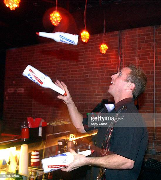 COOCTOBER 26TH 2004Dennis Oakley bartender at the nightclub Vinyl juggles bottles to entertain patrons of the club Tuesday night Femmes Night THE...