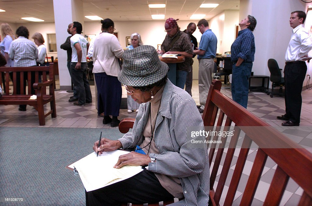 DENVER COLORADO OCTOBER 4 2004Nora B Thompson <cq> fills out voter registration information sheets during a lunchtime rush at the Election Commission...