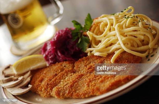 AURORA CO JULY 21 2004Viener schnitzel <cq> made with veal with spaetzel egg noodles and red cabbage for recipe page from Aurora ethnic restaurants